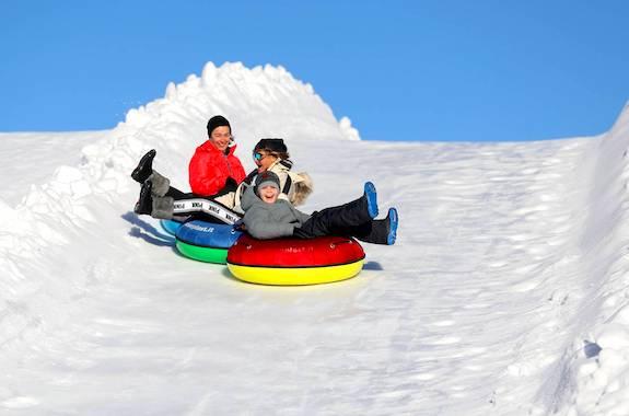 Фото катание на сноутюбинге